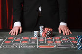 Man playing at the casino — Stock Photo