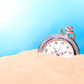 Alarm clock on the beach — Stock Photo