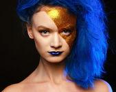 Portrait of young woman in superhero cosmetics — Stock Photo