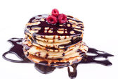 Stack of pancakes with chocolate and raspberry — Stock Photo