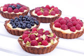 Raspberry and blueberry mini tarts — Stock Photo