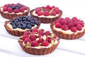 Raspberry and blueberry mini tarts — Stock Photo