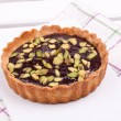 Chocolate tart with pistachio — Stock Photo #22534879
