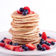 Stack of pancakes with strawberry and blueberry — Stock Photo #22535933