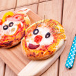 Face on mini pizzas — Stock Photo #22537975
