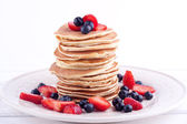Stack of pancakes with strawberry and blueberry — Stock Photo