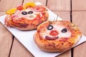Face on mini pizzas — Stock Photo