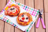 Face on mini pizzas — Stock Photo