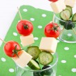 Appetizers with cheese,tomato,cucumber and olive — Stock Photo