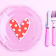 Heart on a pink plate — Stock Photo