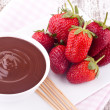 Stock Photo: Chocolate fondue and strawberry