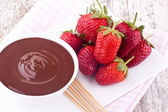 Chocolate fondue and strawberry — Stock Photo