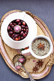 Tea balls and brier in cup — Stock Photo