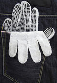Working glove in the back pocket of old used jeans — Stock Photo
