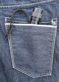 Flashlight in the back pocket of jeans — 图库照片