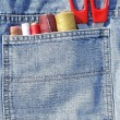 Closeup to jeans pocket with tailor tools — Stock fotografie