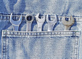 Back pocket of jeans with tools — Stock Photo