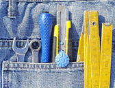 Tools and jeans pocket — Stock Photo