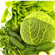 Lettuce, Savoy cabbage and cucumbers in white — Stock Photo