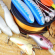 Stock Photo: Fishing equipment on wooden