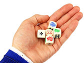 Dices in hand isolated on white background — Stockfoto