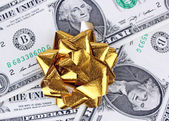 Gift with dollars — Stock Photo