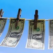 Stock Photo: 1 dollar bills hanging on clothesline