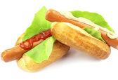 Tasty hot dog isolated on white — Stock Photo
