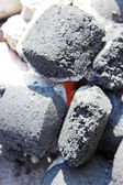 Horizontal image of hot charcoal fire ready for barbecue with — Stock Photo