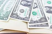Dollars in book — Stock Photo