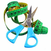Modern blue scissors and measuring tape isolated — Stock Photo