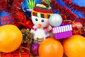 Christmas ornaments and oranges — Stock Photo