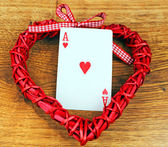 Red heart on a board with an ace heart — Stock Photo