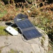 Solar energy charging cellphone — Stock Photo
