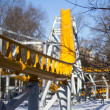 Yellow roller coaster - Stock Photo