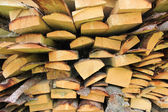 Stacked firewood in a pile — Stock Photo