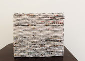 Weave in newspapers — Stock Photo