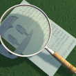 Stock Photo: Magnifying glass and letter