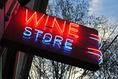Neon sign over a wine store — Stock Photo