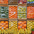 Different colorful fruits organized in crates — Stock Photo