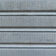 Patterned grey metal curtain texture — Stock Photo
