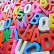 Colorful letter texture chaos word — Stock Photo