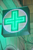 Flashy pharmacy luminous sign — Stock Photo