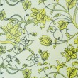 Floral pattern on old table cover — Stock Photo