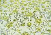Floral pattern on old table cover — Stockfoto