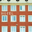 Hotel windows over brick wall — Stock Photo