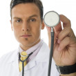 Doctor Holding Stethoscope - Stock Photo