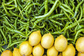 Green Peppers And Lemons — Stock Photo