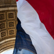 Stock Photo: French Flag at Arc de Triomphe