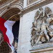 Stock Photo: Arc de Triomphe with French Flag